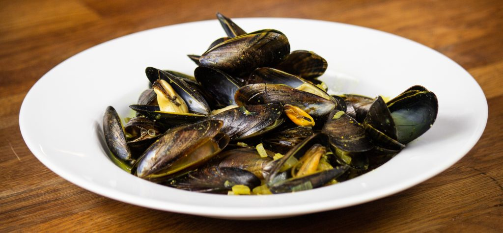 Mussels served on a white plate